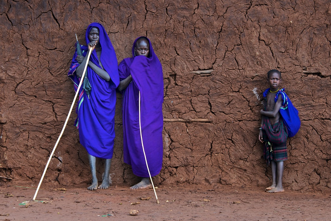 Suri tribesmen waiting for a stick fight (donga) to commence in the village of Kibbish in the North Western Omo valley.