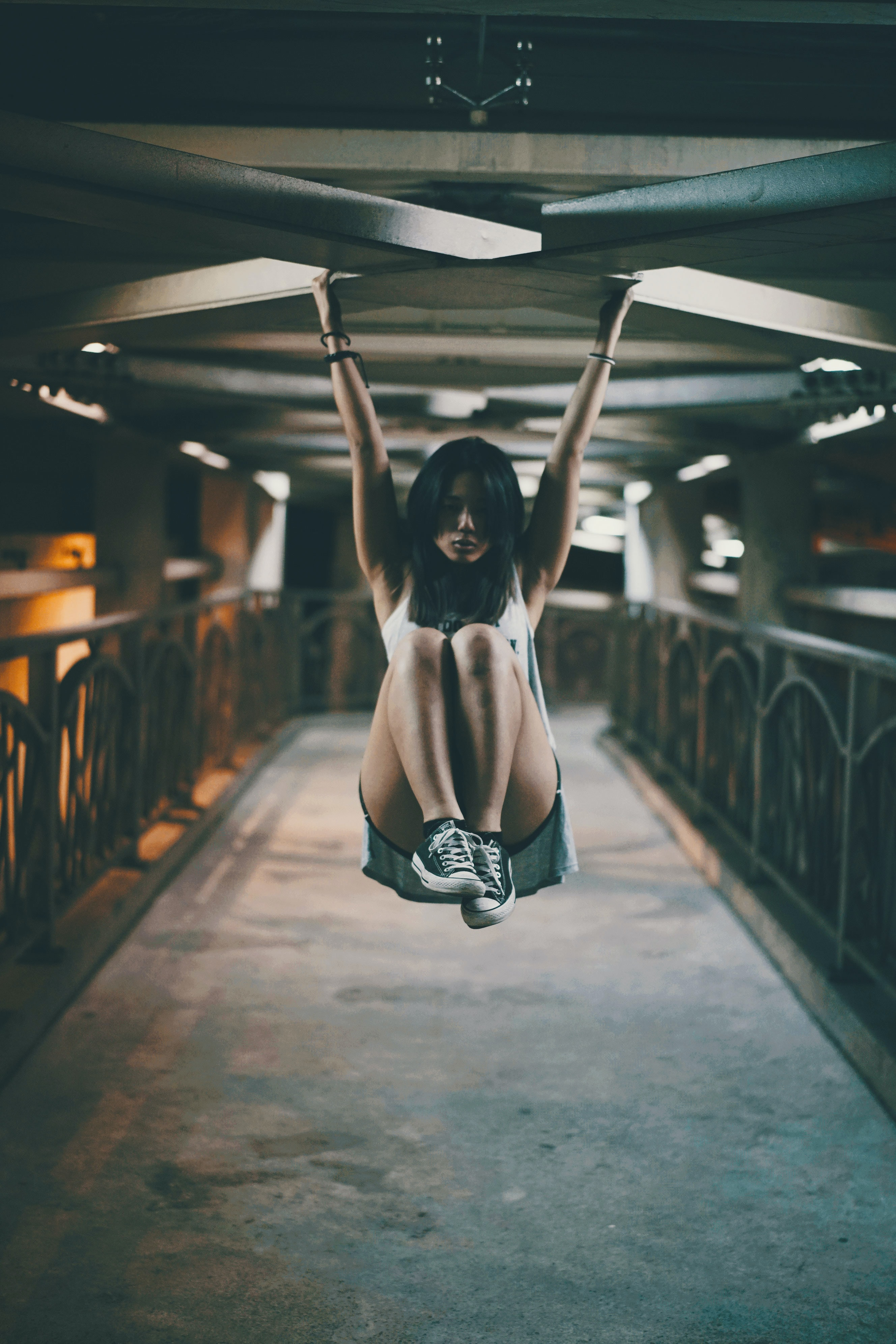woman hanging on x shape ceiling
