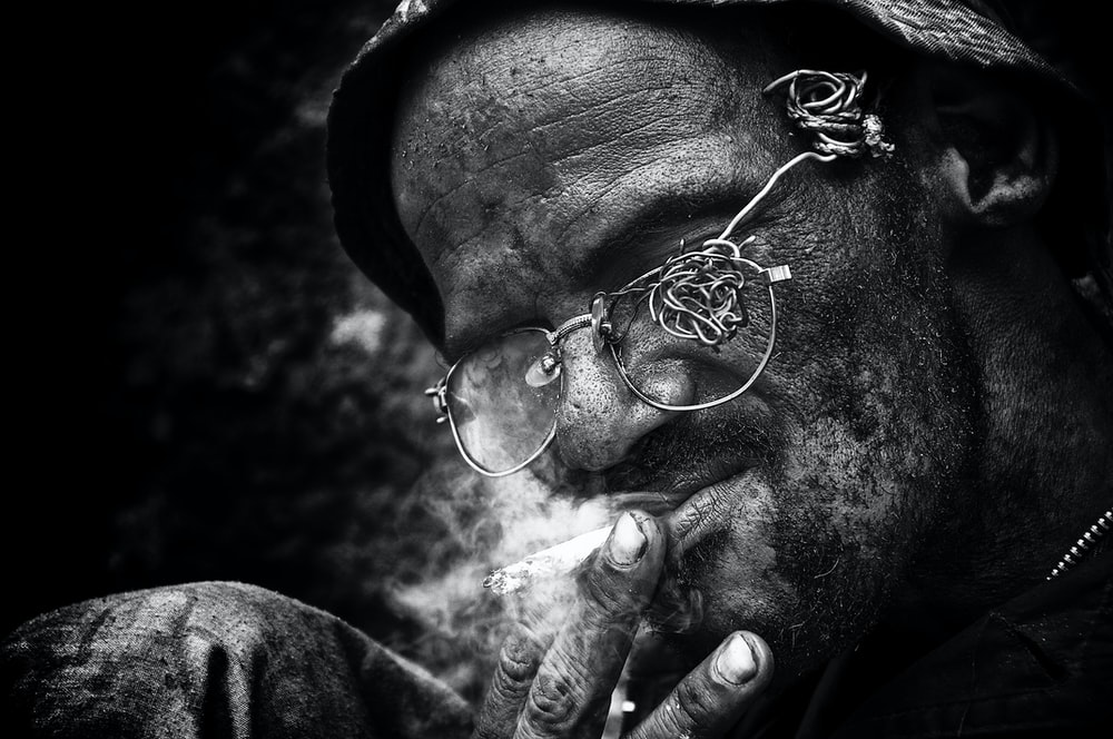grayscale photography of person smoking