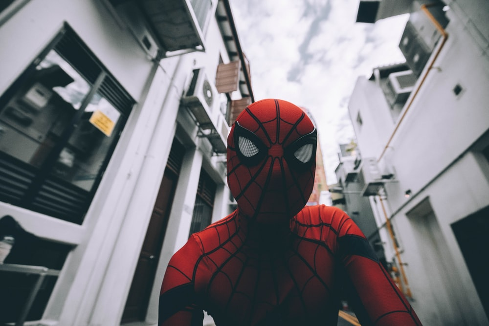Spider-Man standing in the middle of buildings