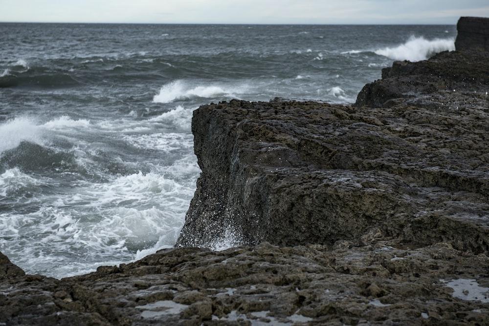 cliff beside ocean