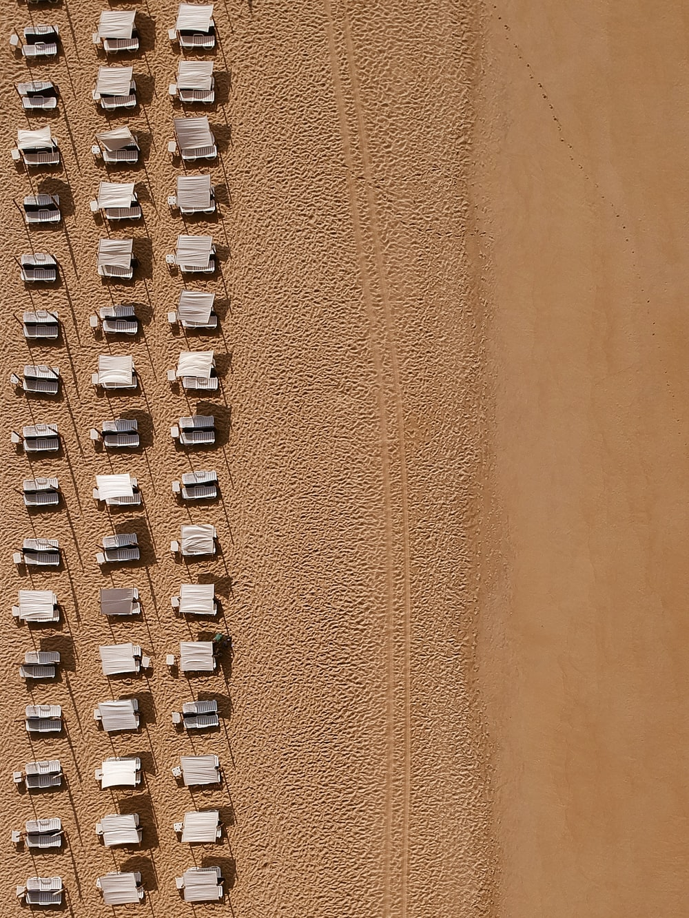 aerial photography of sunloungers
