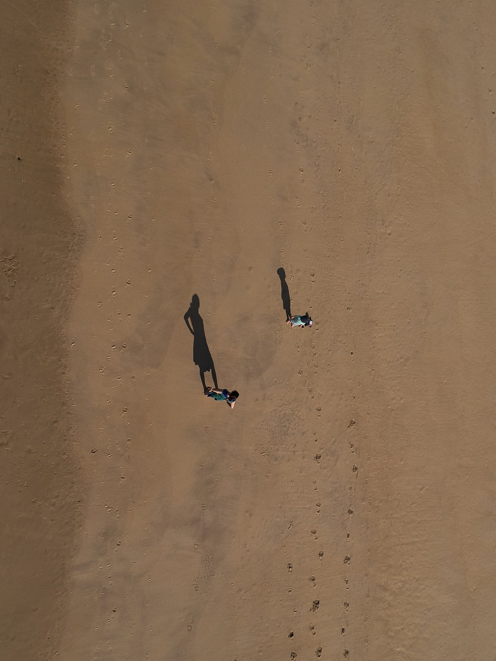 two person standing on desert at daytime