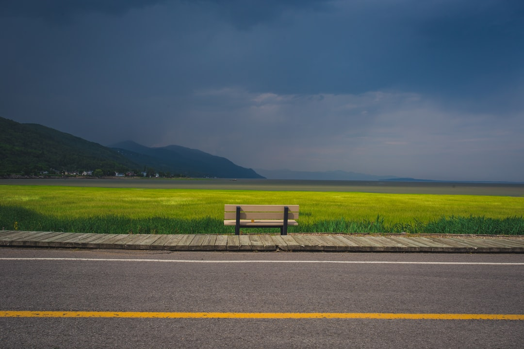 - Part of a 30 days streak of Unsplash uploads -  I've went up North 3 times. I've stopped at Petite Rivière Saint François 3 times. I've taken a picture of this bench 3 times.  It's part of the tradition, and I can't think of driving there without stopping to take a picture of this scenic landscape.