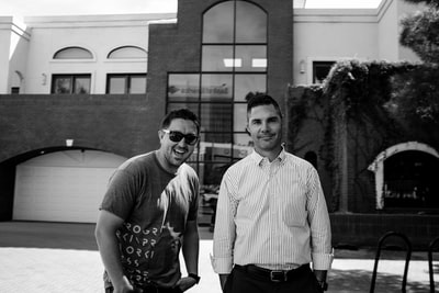 grayscale photography of two smiling men