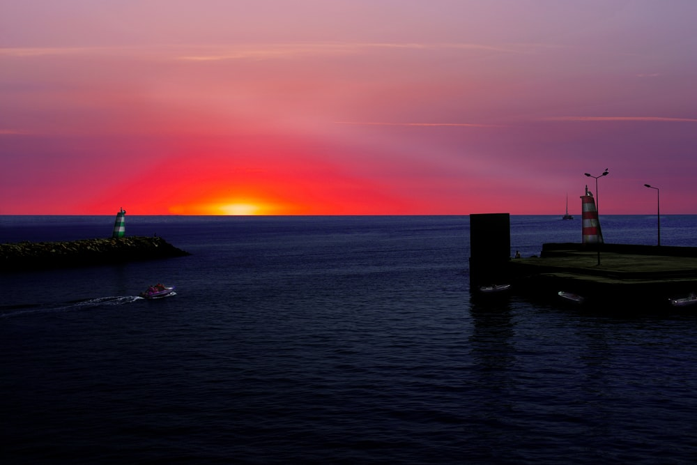 blue ocean water under sunset