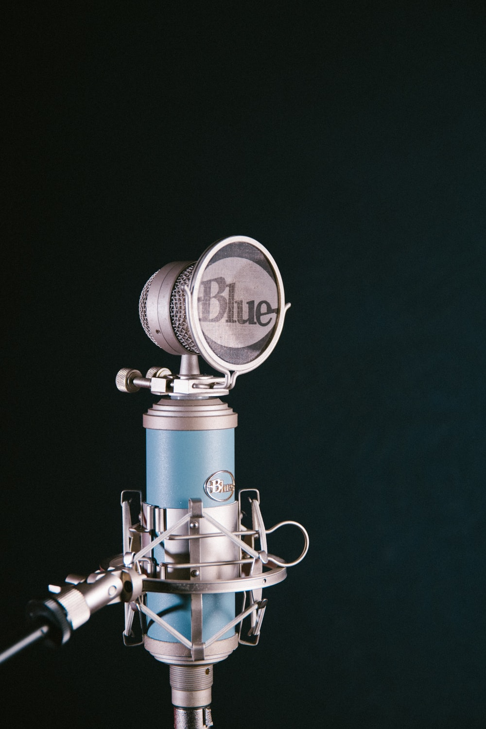gray and blue Blue condenser with pop filter