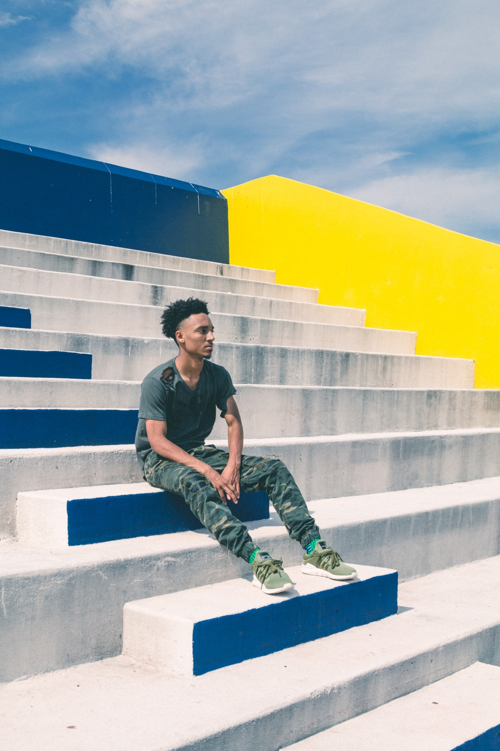 man sitting on concrete stairs