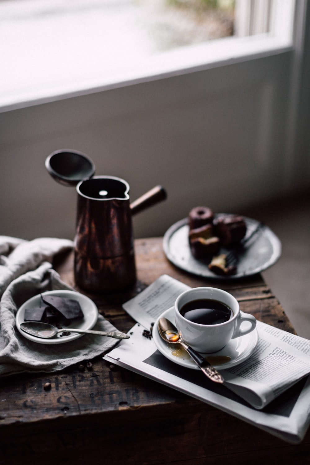 coffees in white ceramic mug on brown wooden table