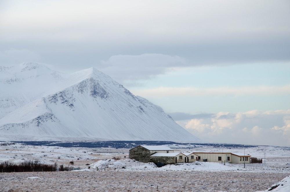 white house near snow mountain