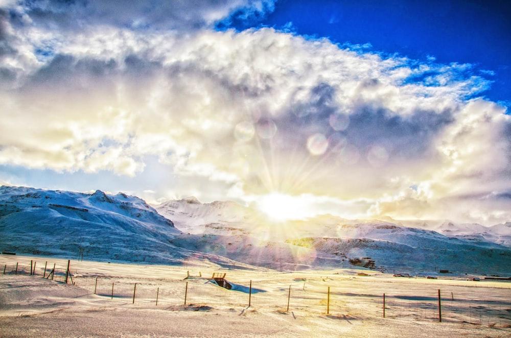snow mountain under white clouds