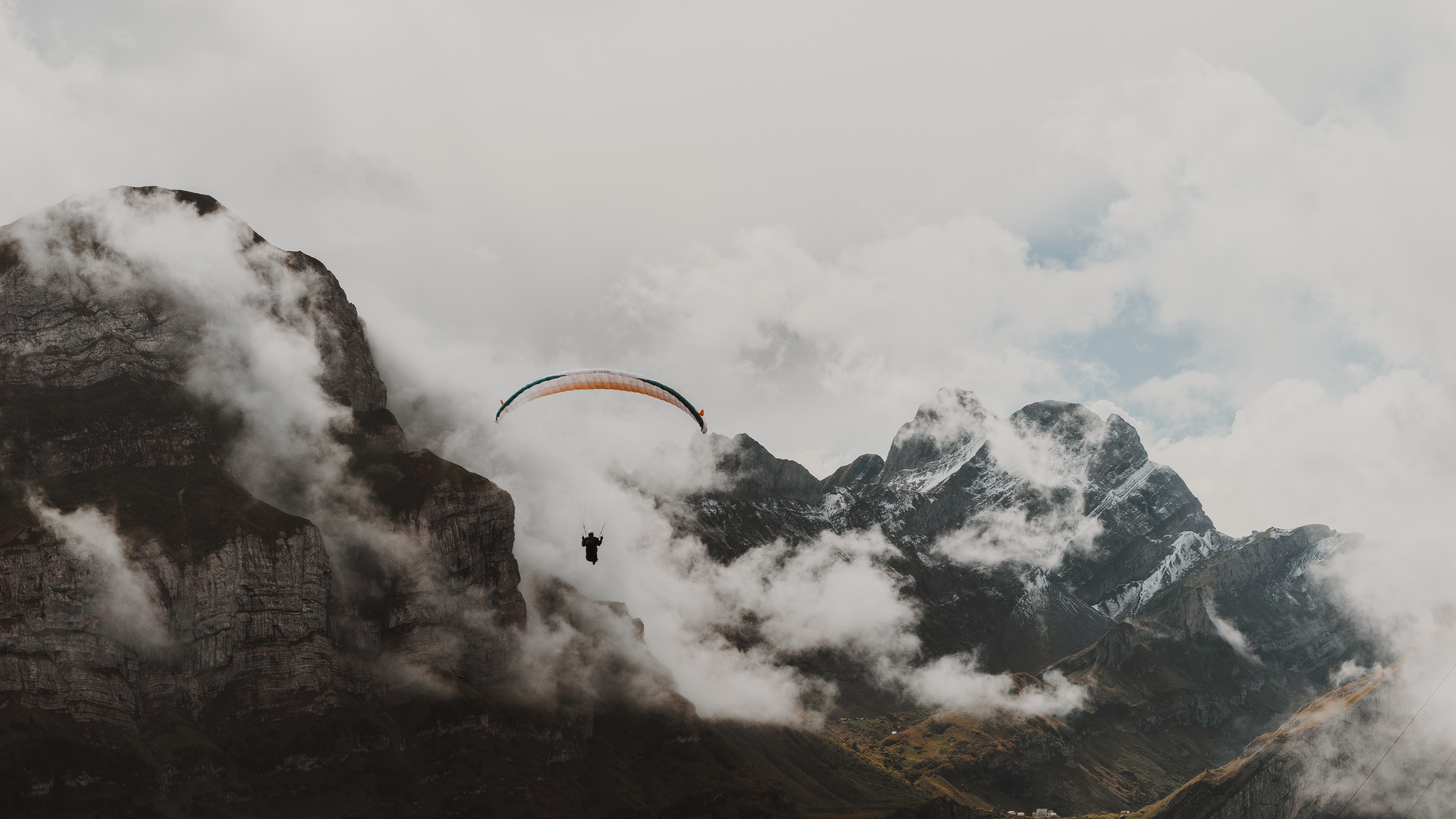 person on parachute near the mountain