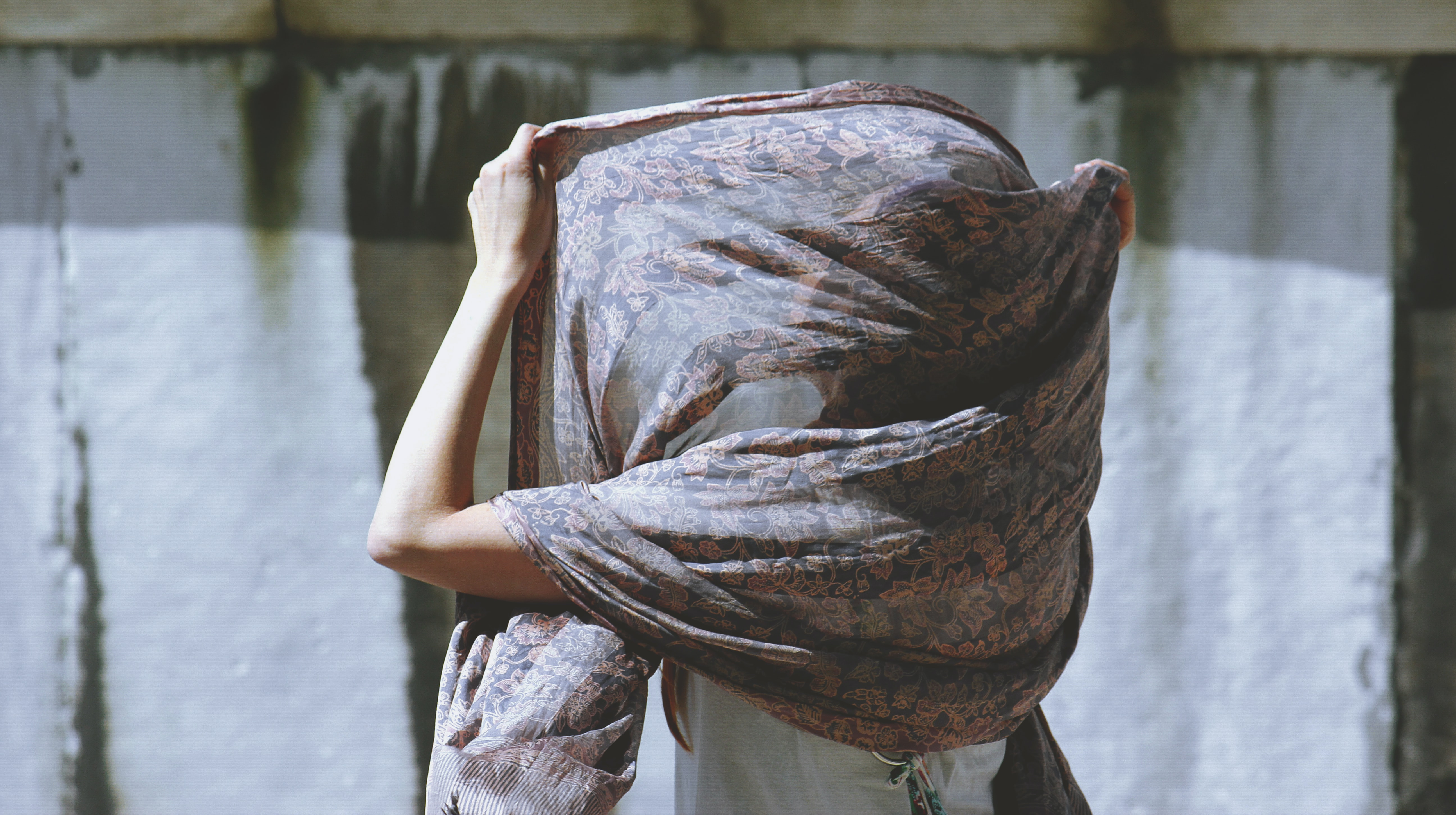 woman using brown floral scarf