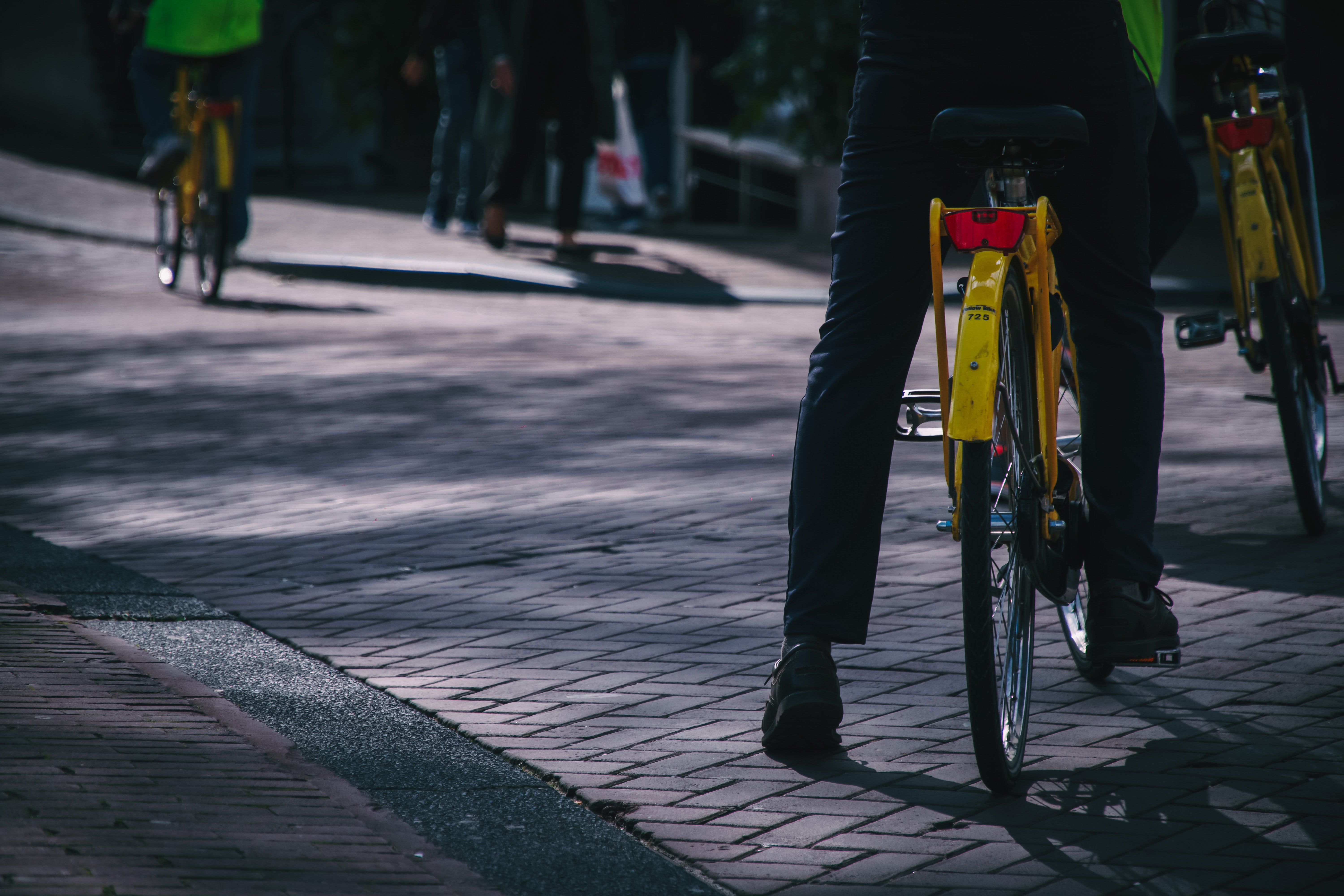 person riding on yellow bicycle during daytime