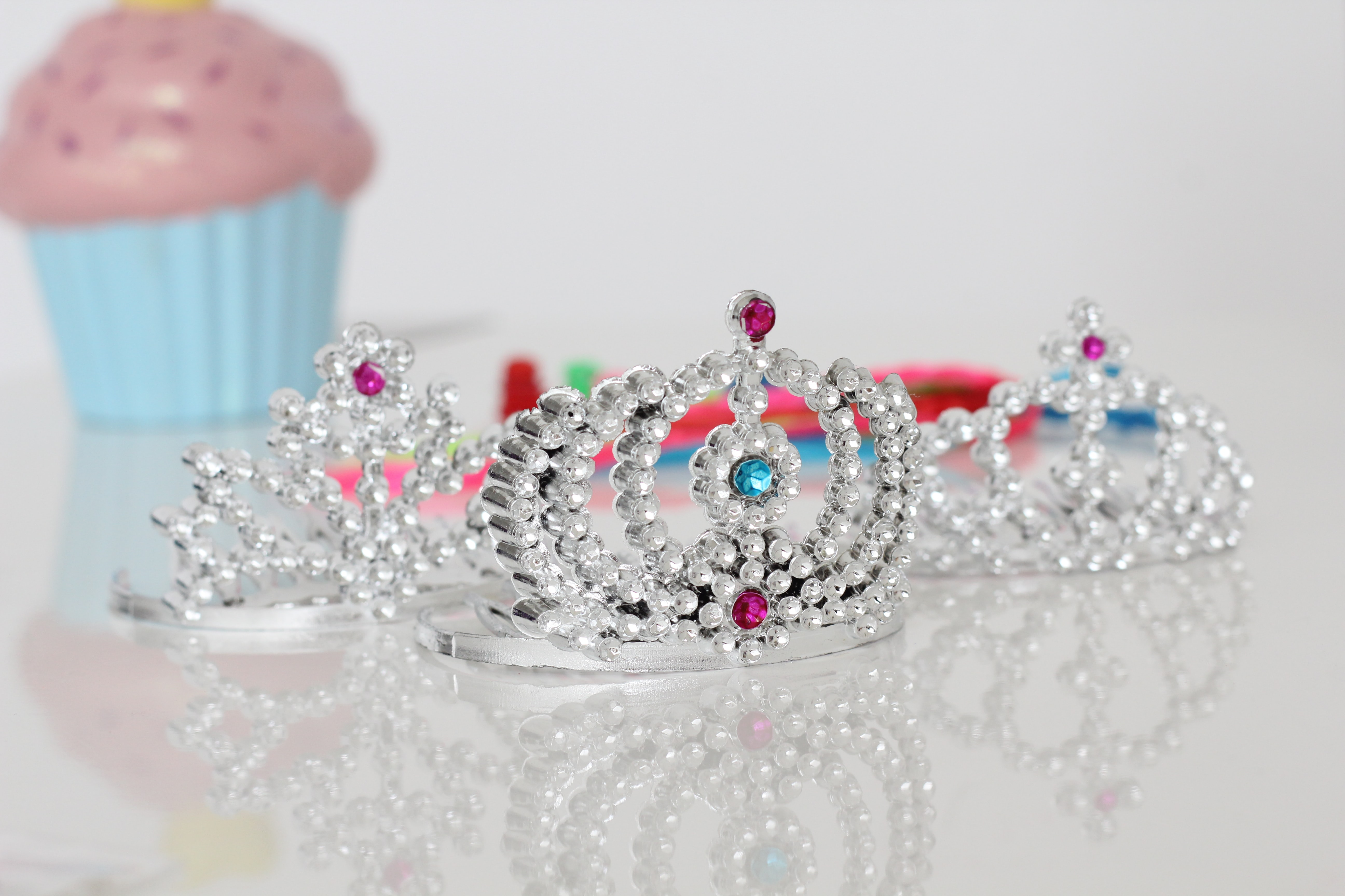 silver-colored tiara rings with clear gemstones