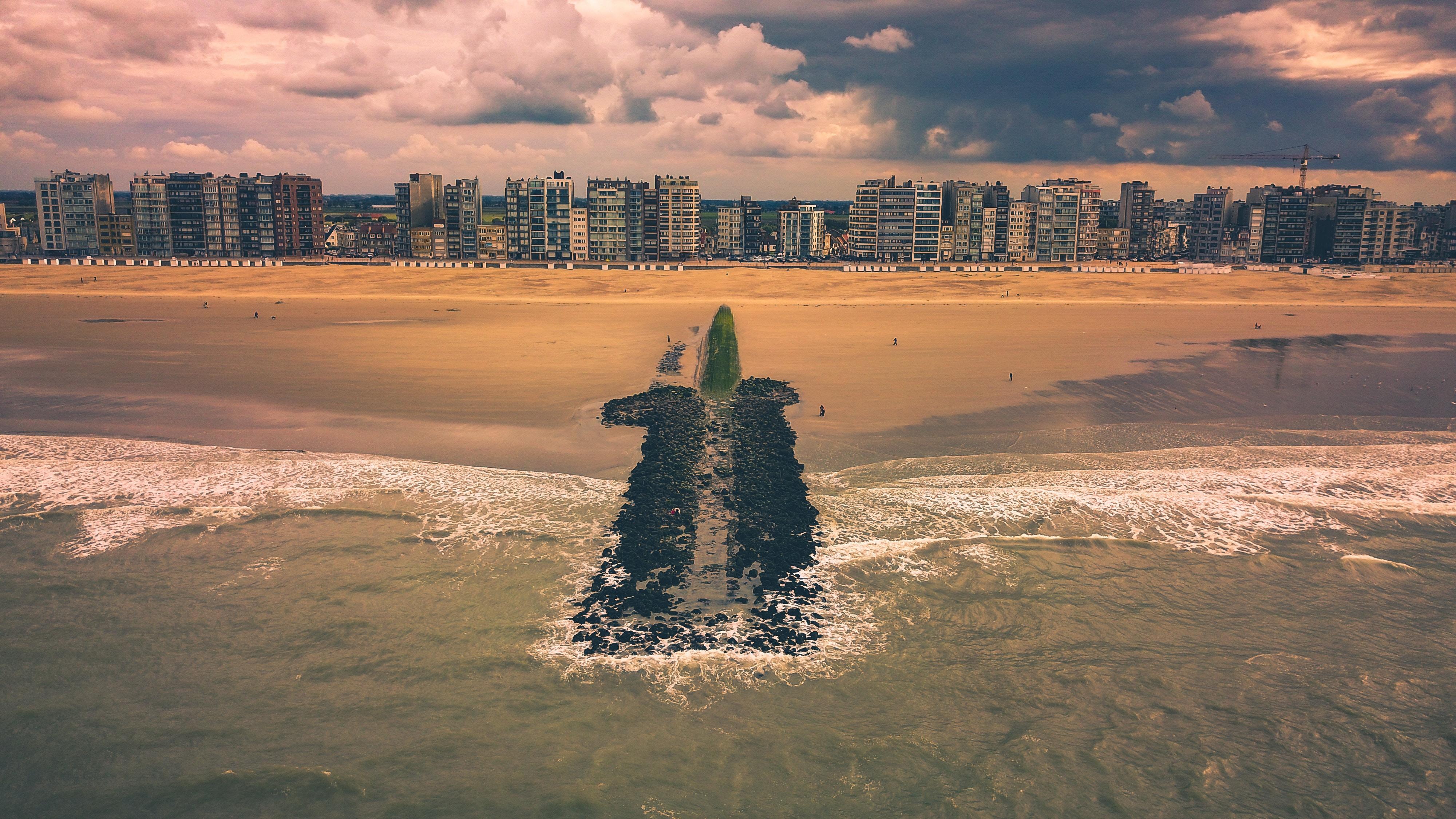 city buildings across beach shore