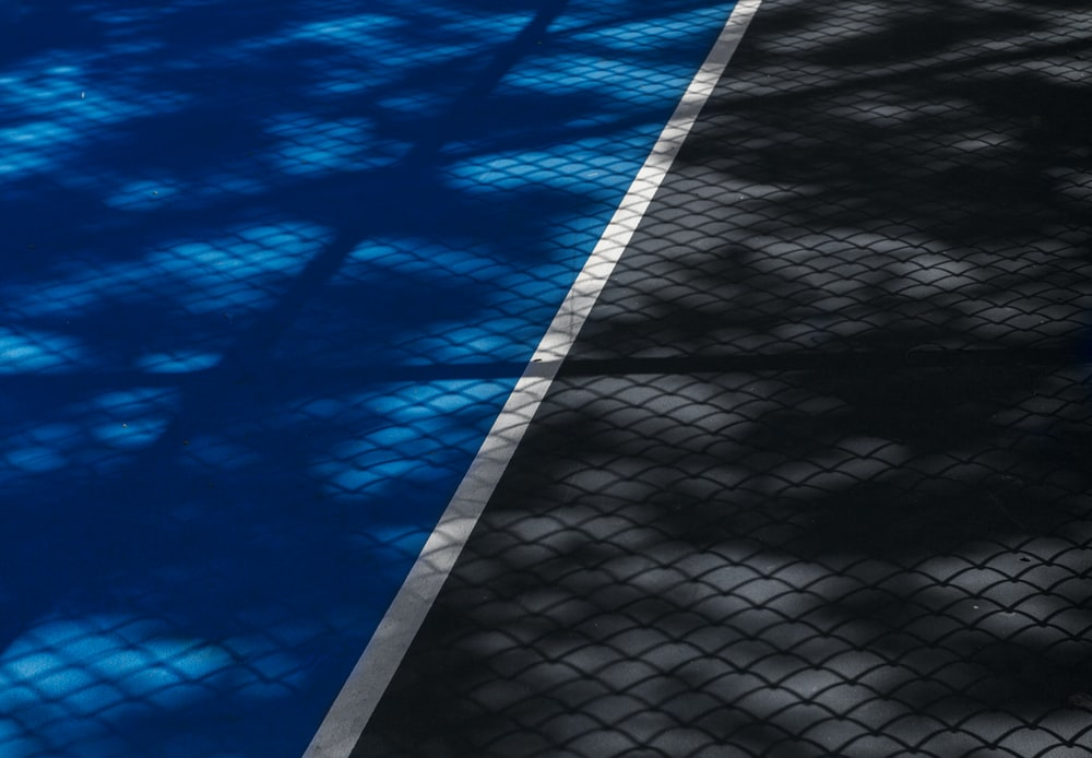 shadows on blue and gray sports field