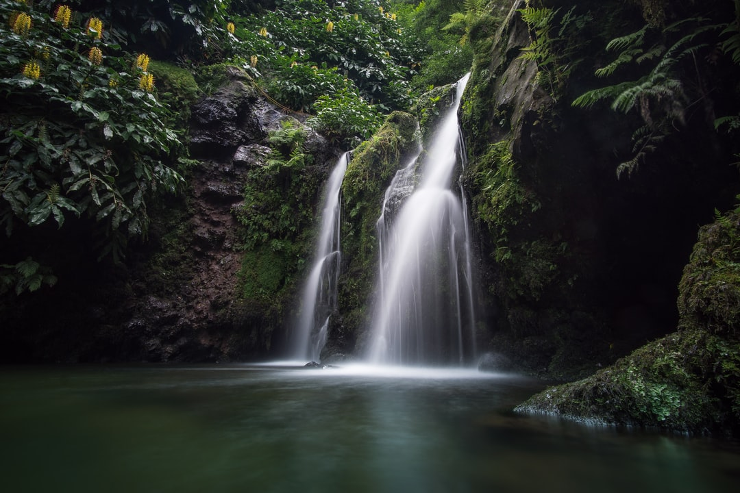 Sometimes it's important to go further than the obvious destination, to go further than all the overcrowded places. We found this waterfall during a hike on Sao Migual. And the best thing was: We were alone there