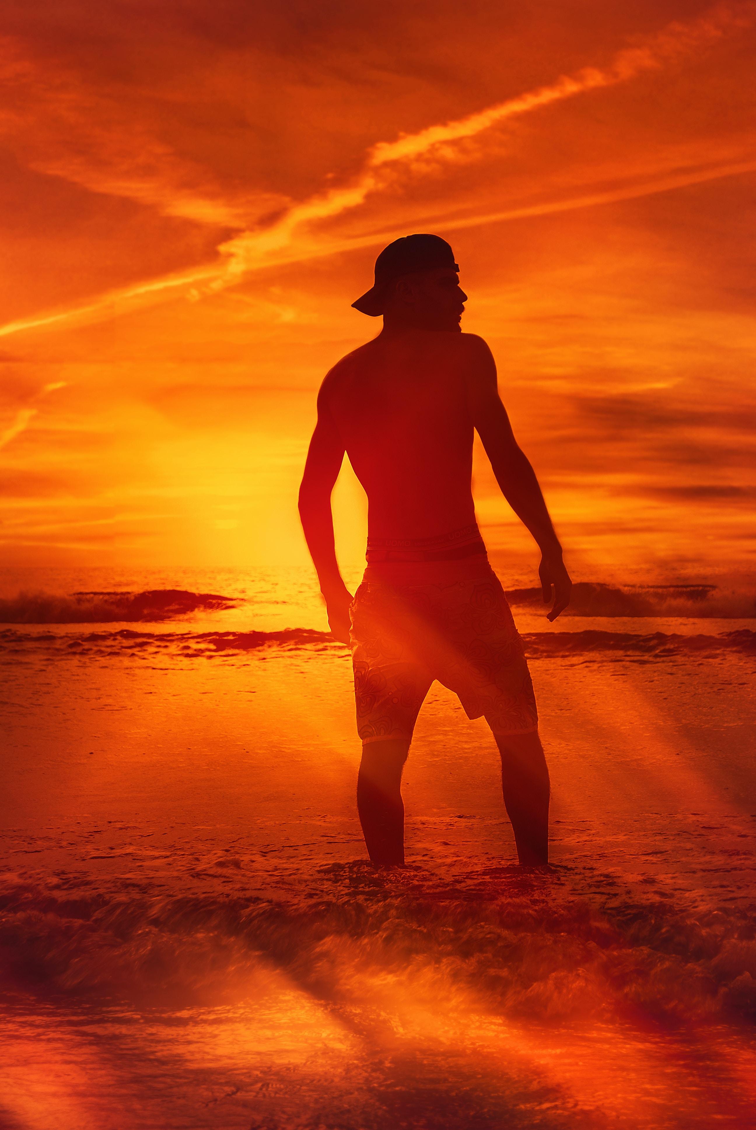 man standing in beach shore