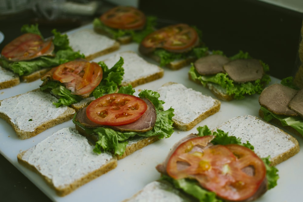 sliced tomatoes, lettuce, with patty sandwiches