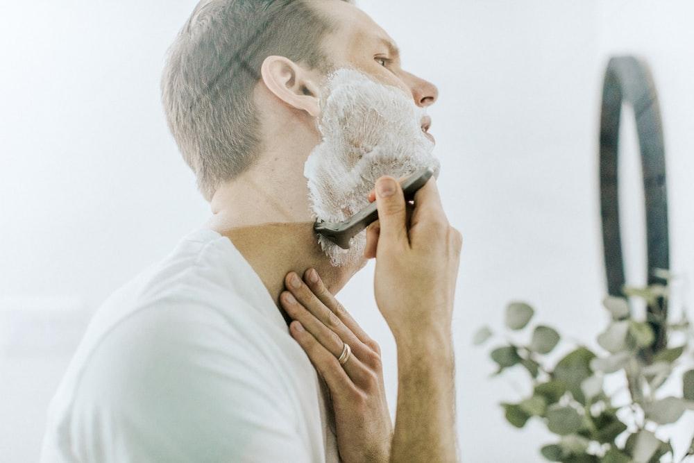 man shaving his beard