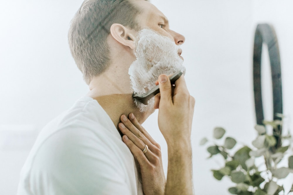 Person shaving their stubble.