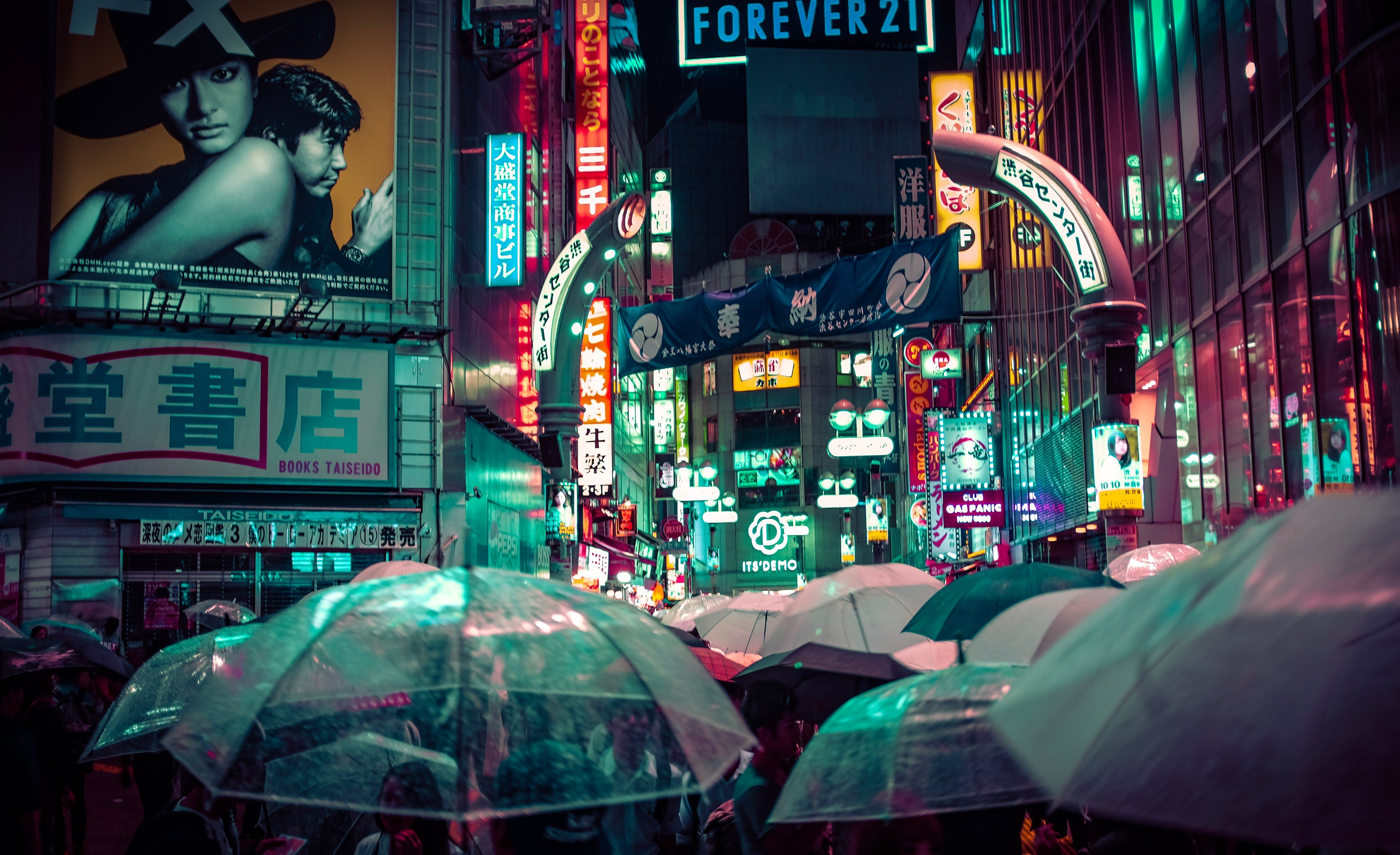 many people using umbrella during nitght time