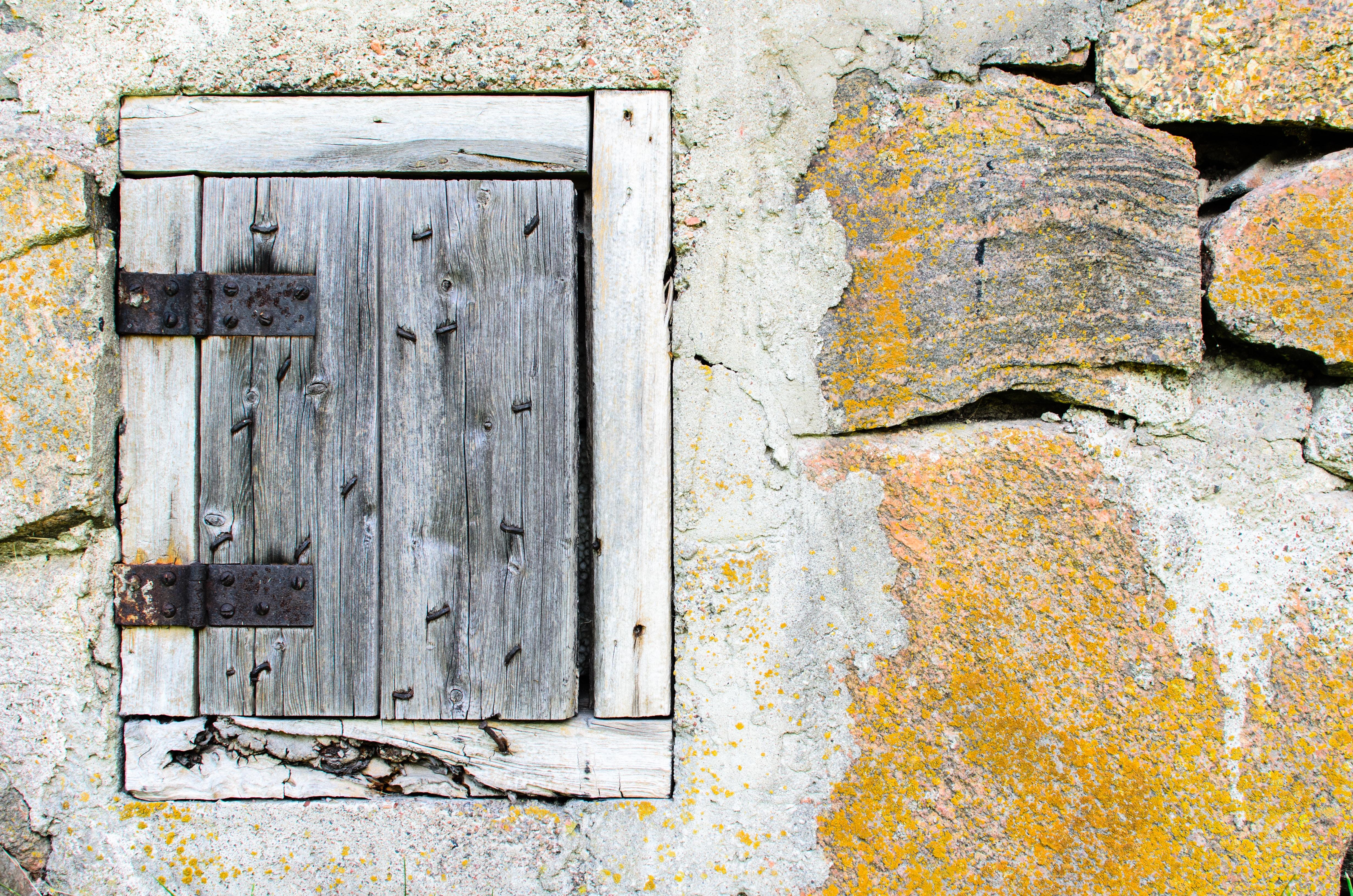 grey wooden window on concrete wall