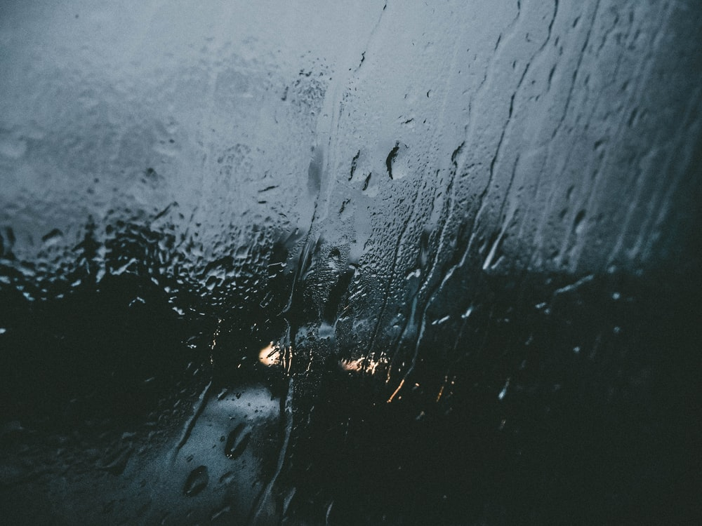 closeup photo of window with water drops