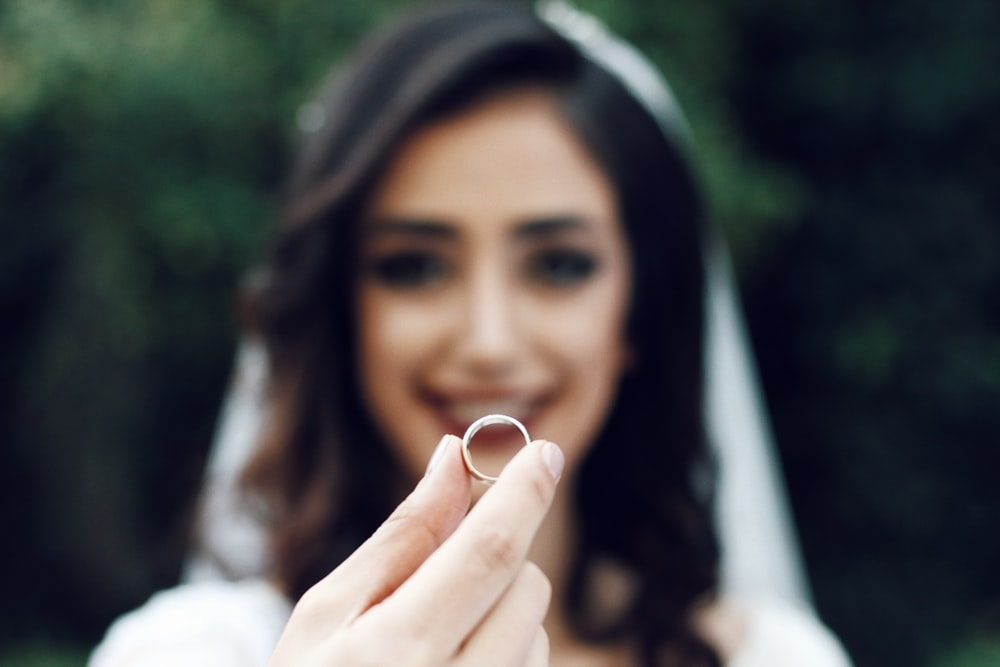 woman holding ring