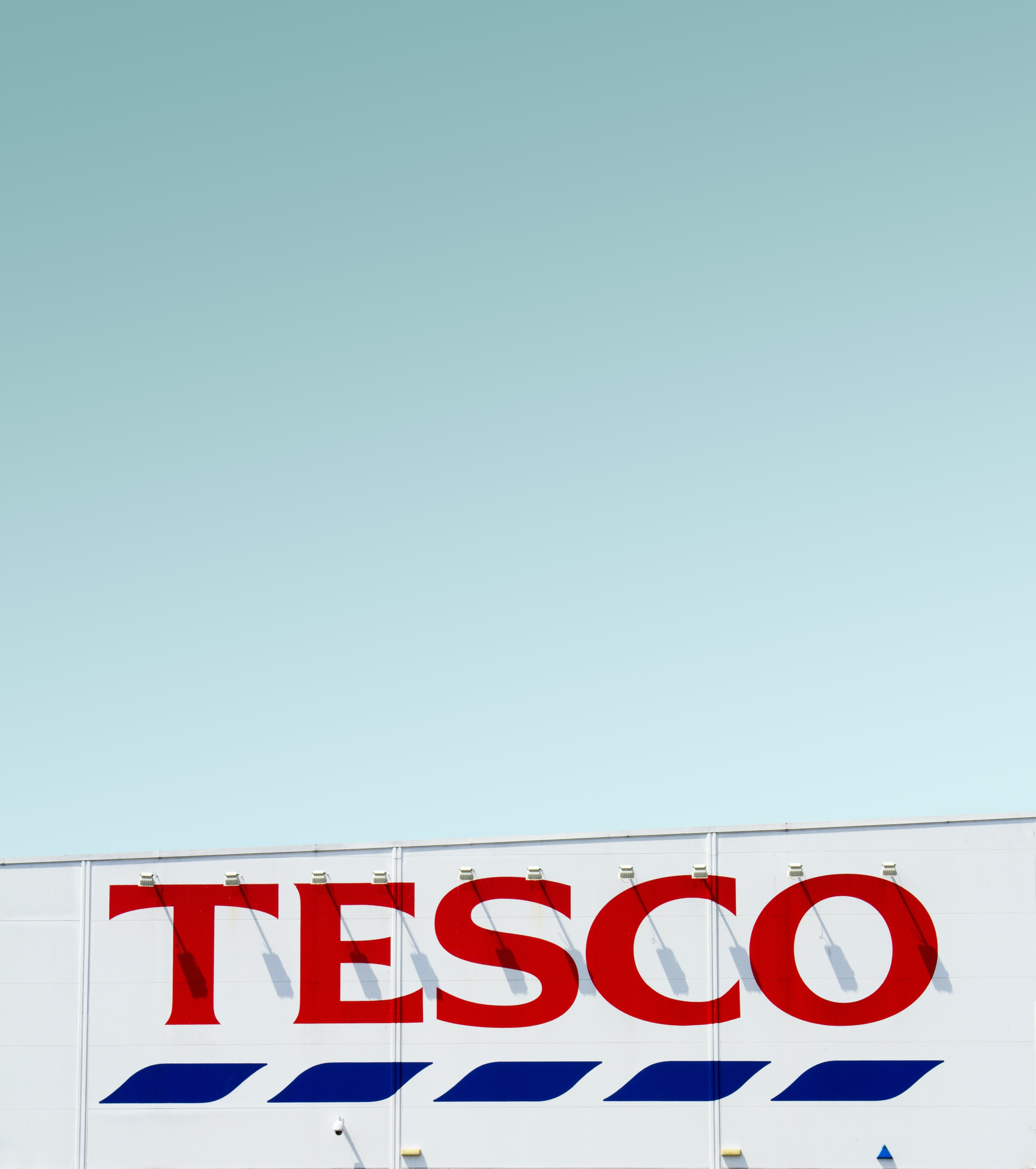 Tesco building under clear blue sky