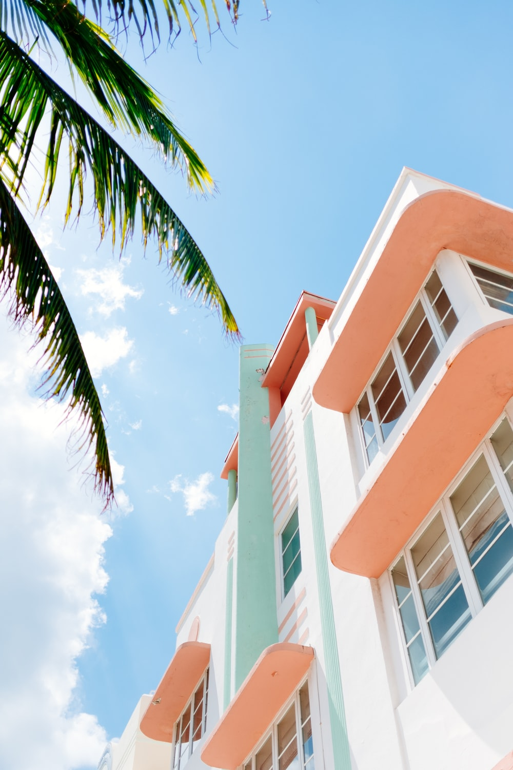 low angle photo of white and orange concrete building
