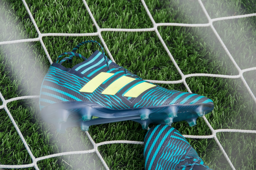 Football cleats in the net.