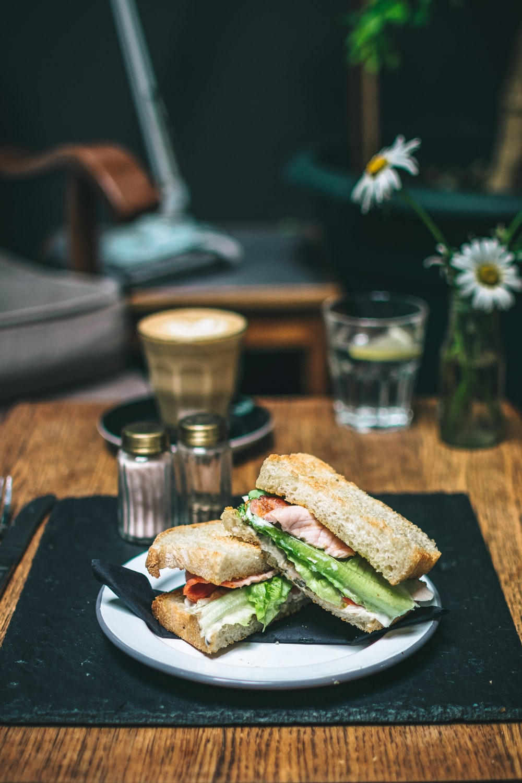 ham sandwich on white ceramic plate