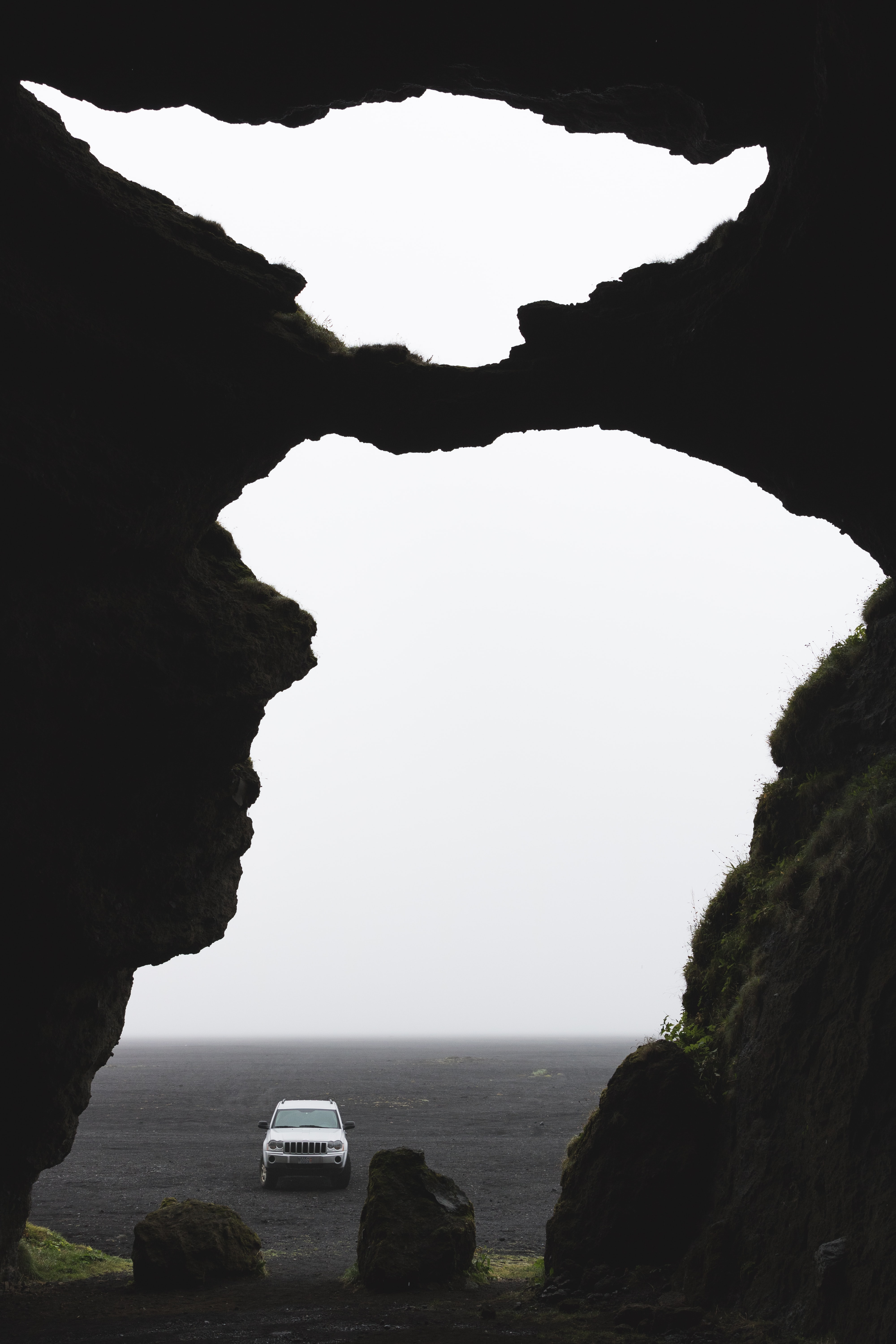 white car between rock formation