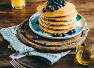 blue and white ceramic plate with pancakes