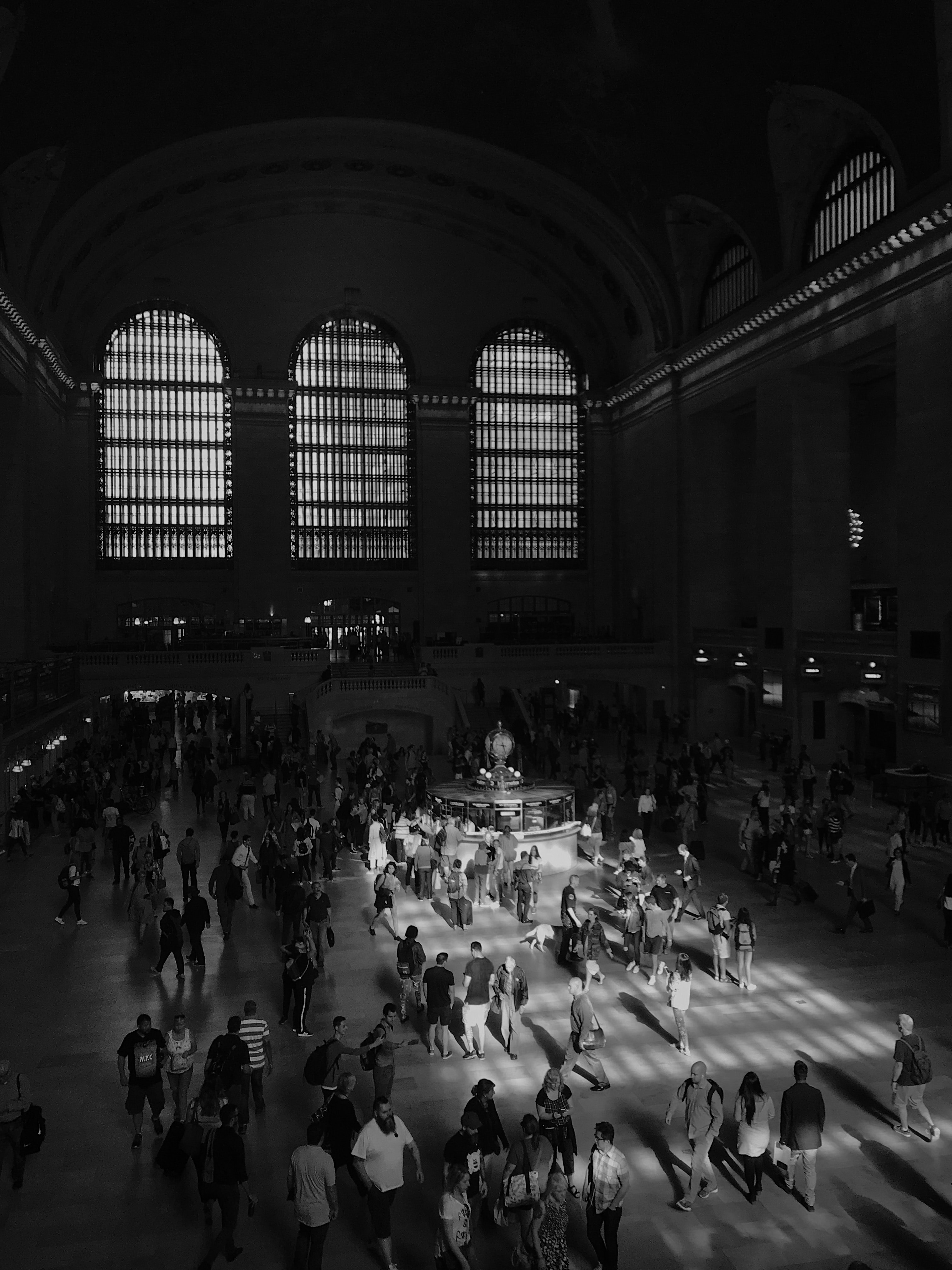 grayscale photography of people inside building