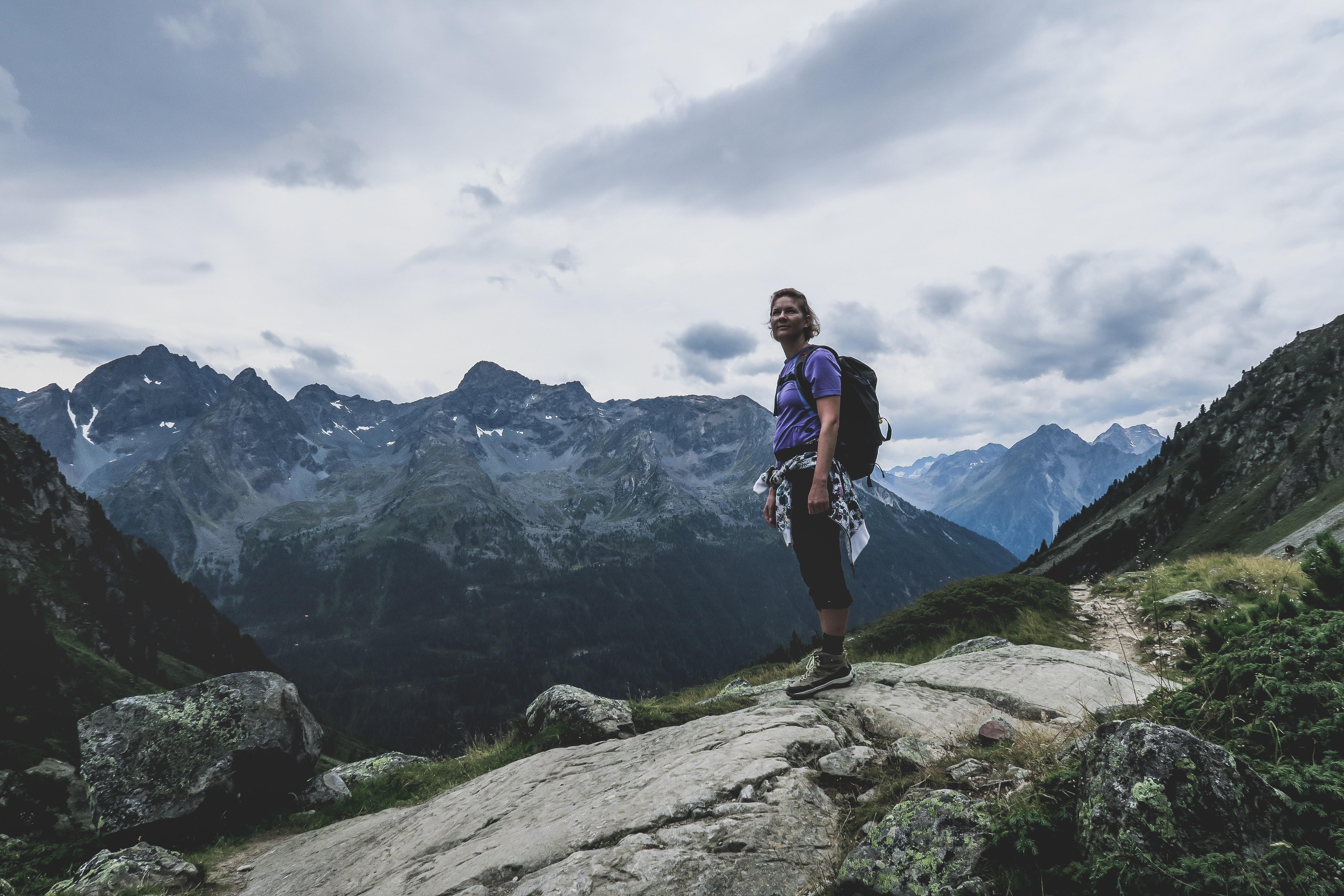 man on cliff mountain