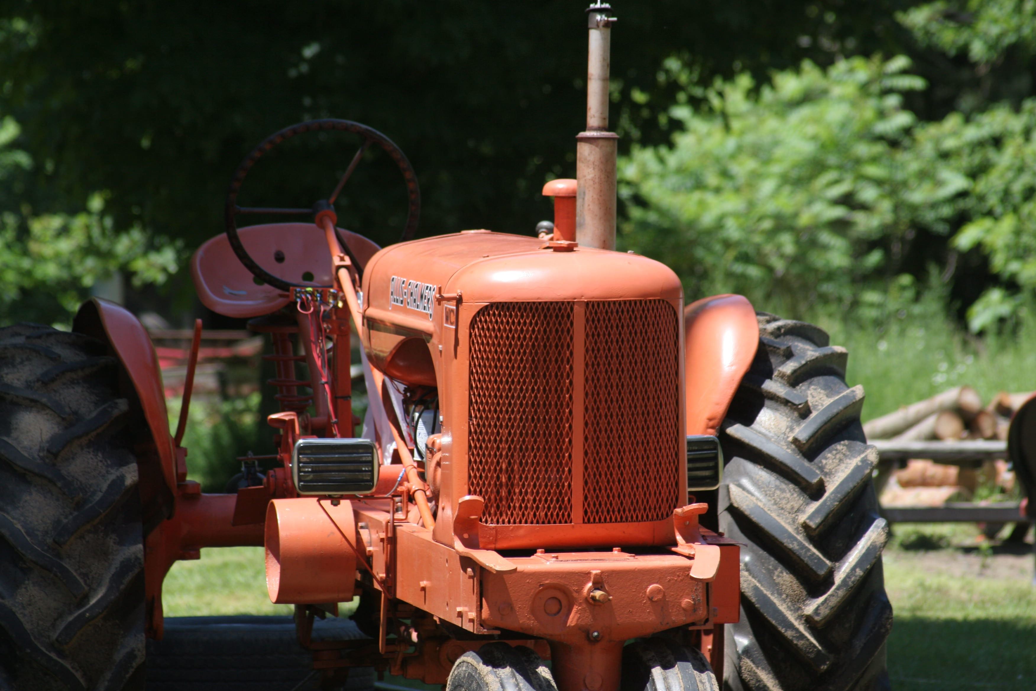 brown tractor on green grass field during daytime