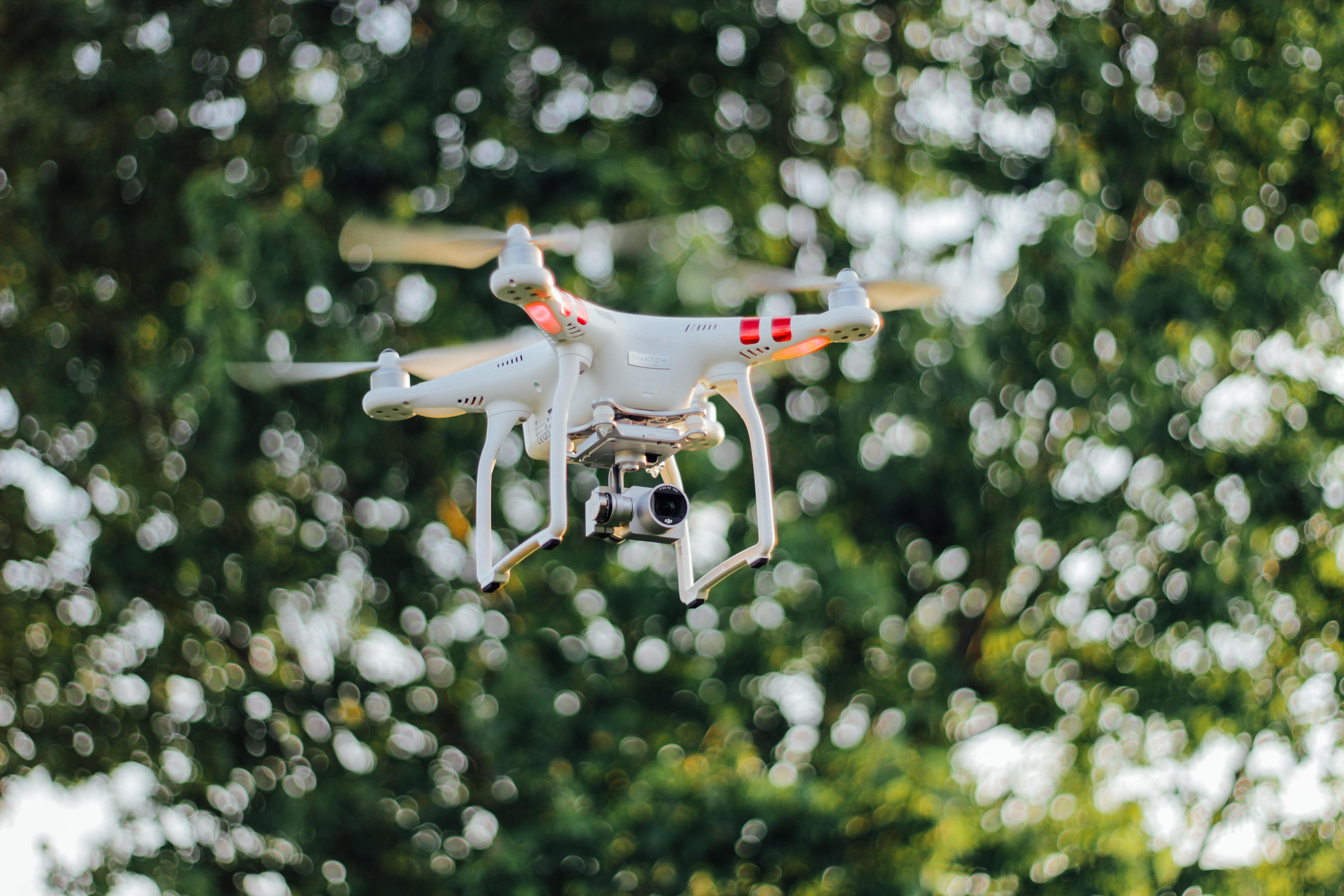 DJI Phantom drone flying midair