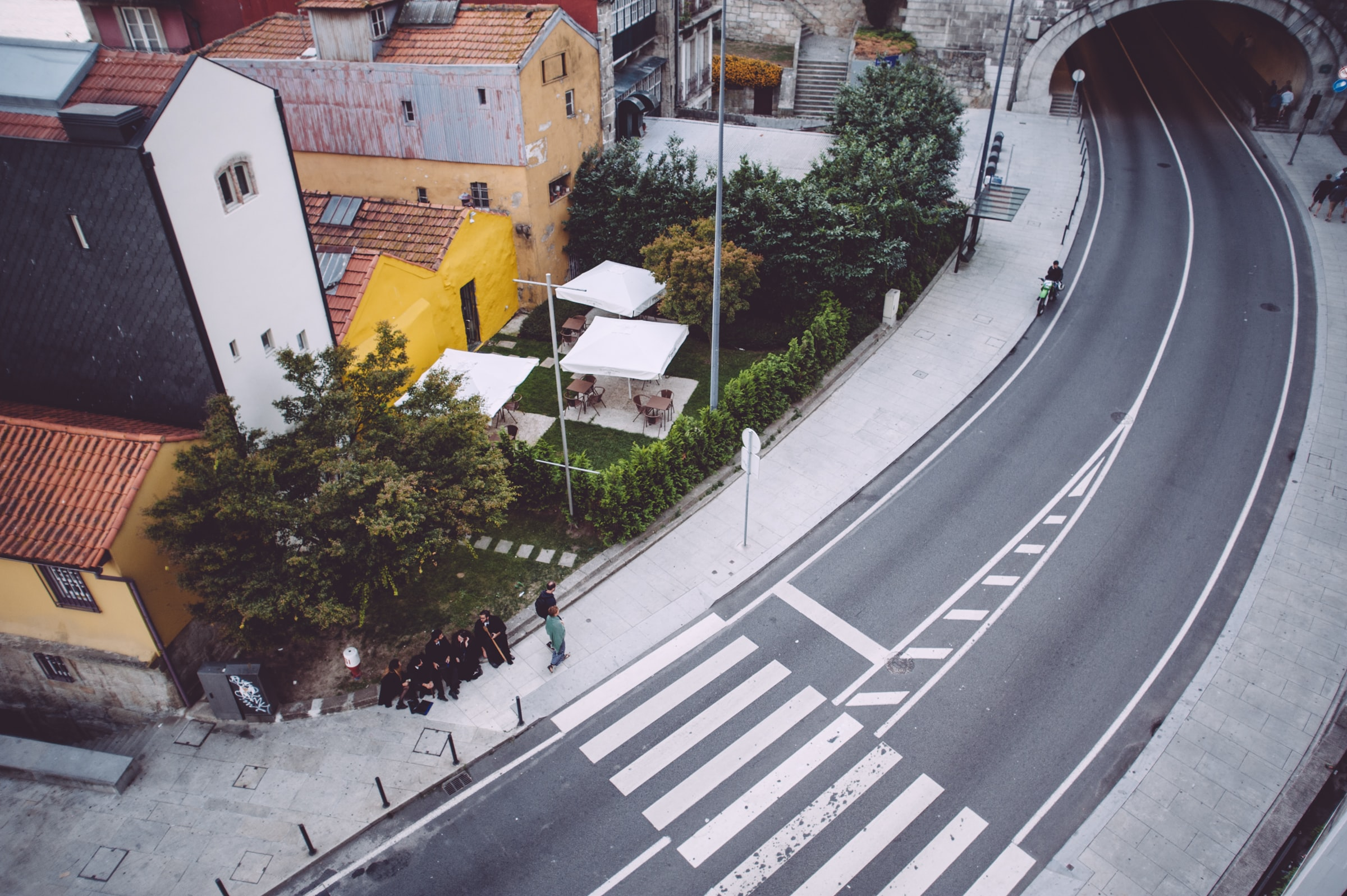 aerial photograph of people sitting near concrete road