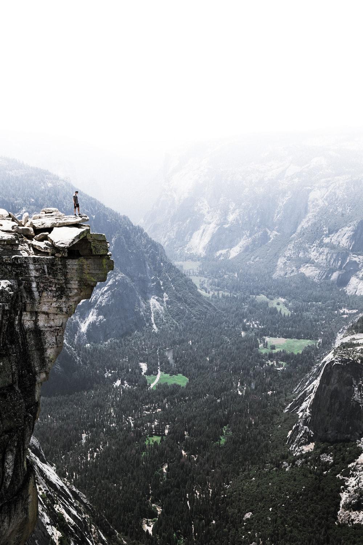 man on mountain cliff