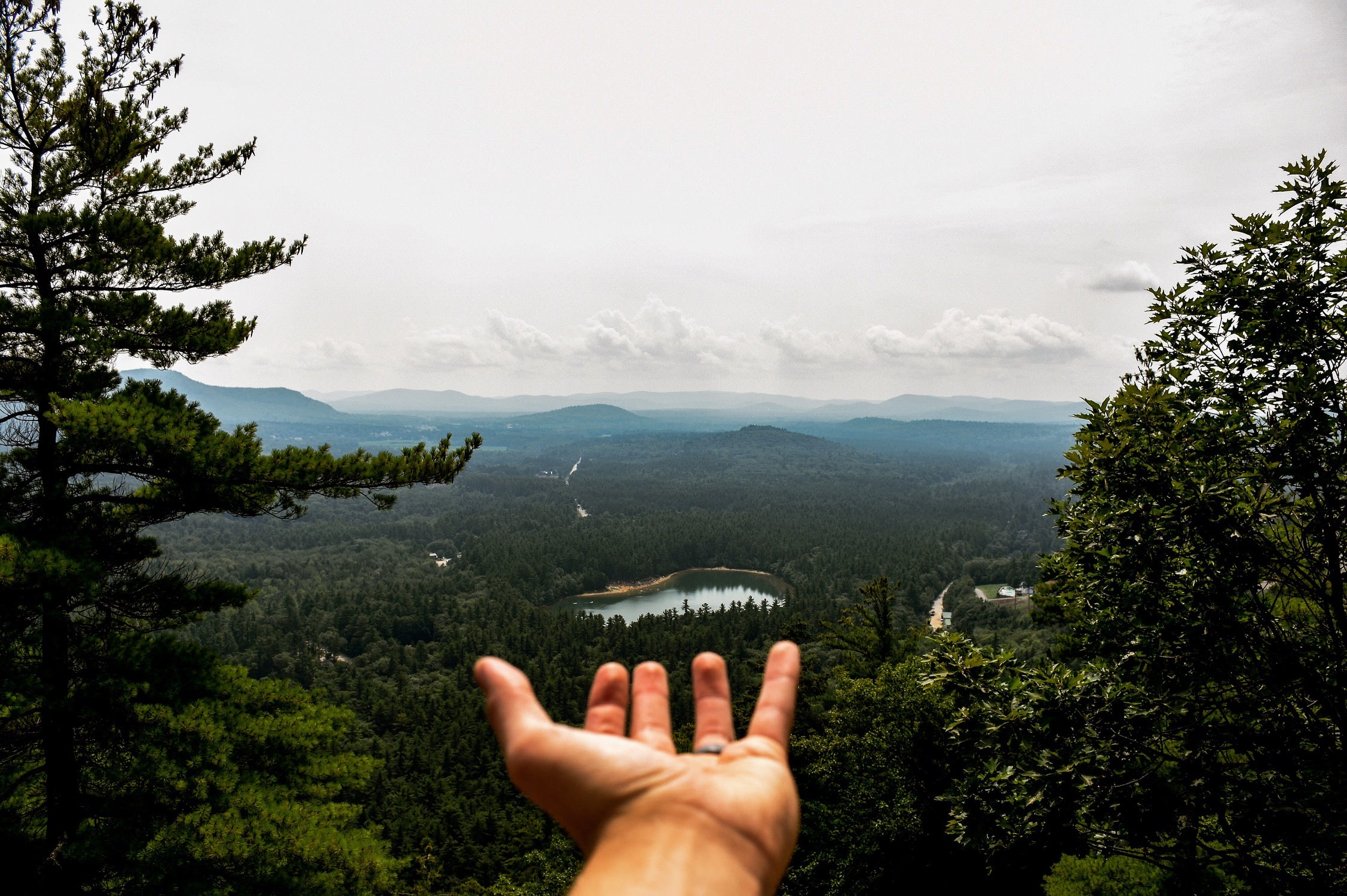 My husband and I embarked on a journey through New Hampshire. Having decided to hike to the top of a mountain, we discovered Lake Echo in the distance. Our dreams are not always as far as they seem.
