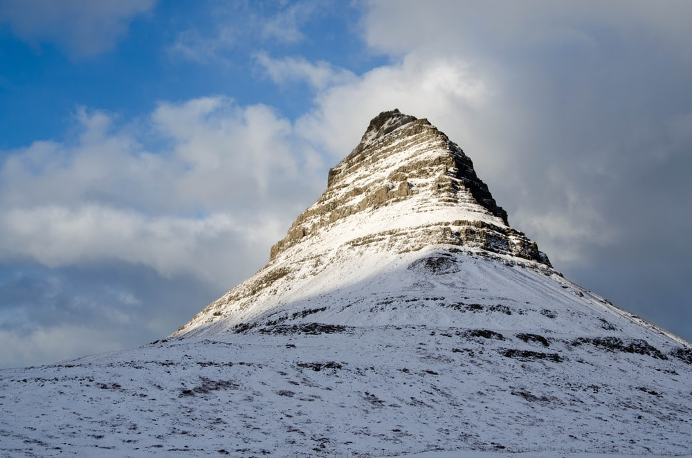 worm's eye view photography of snowy mountain