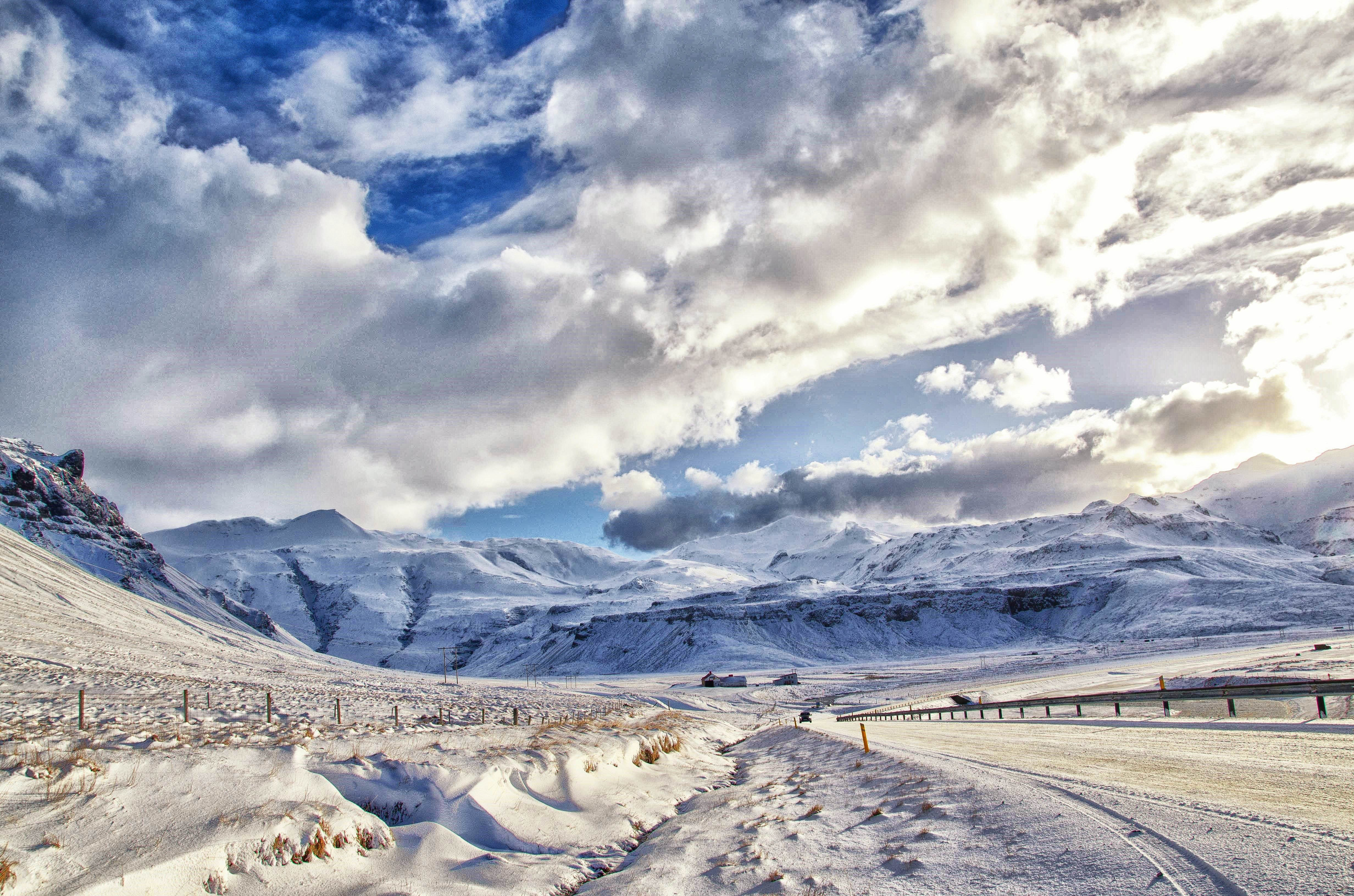 landscape photography of snowy mountain under cloudy sky