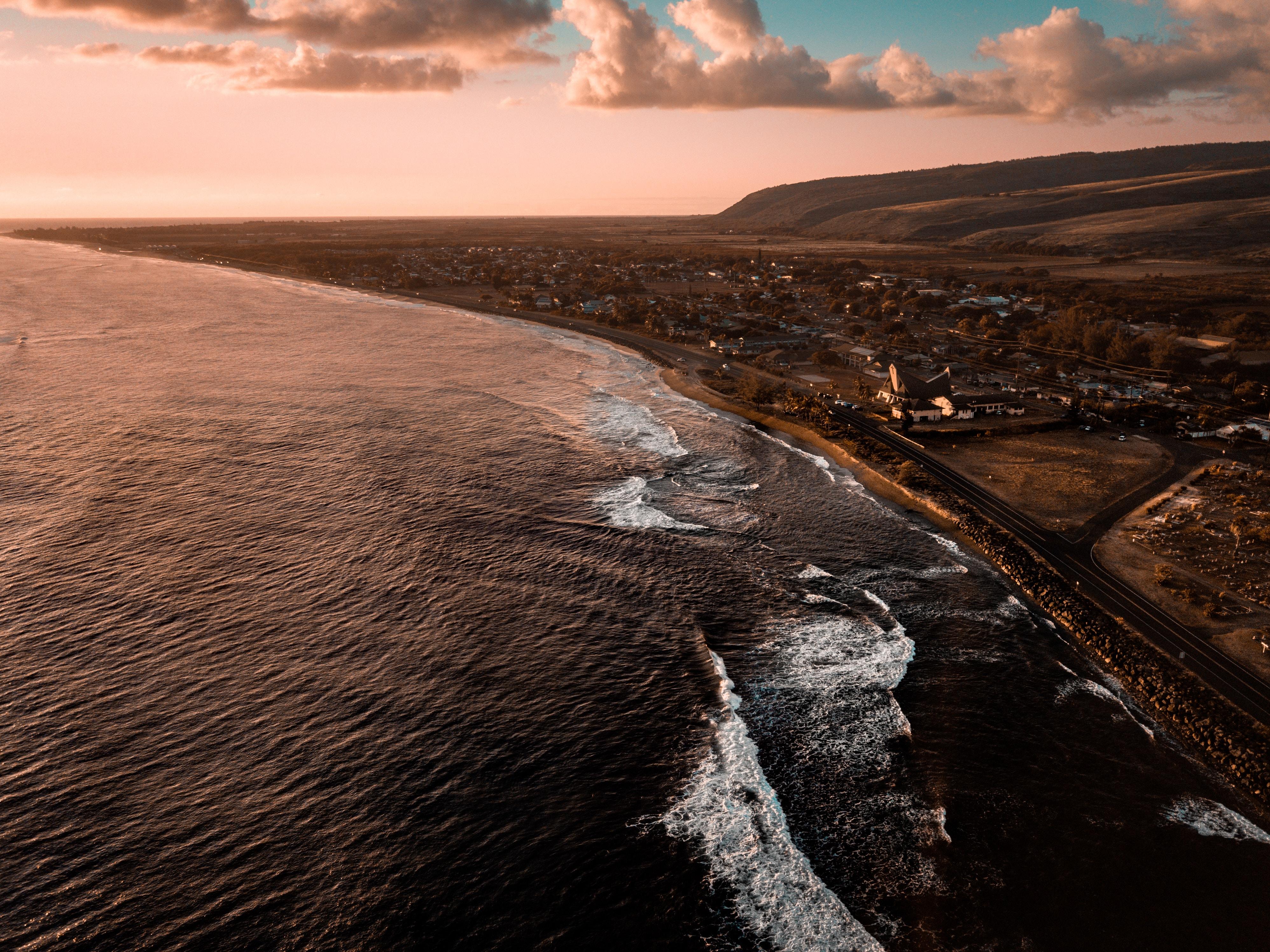 bird's eyeview photo of waves crashing sand