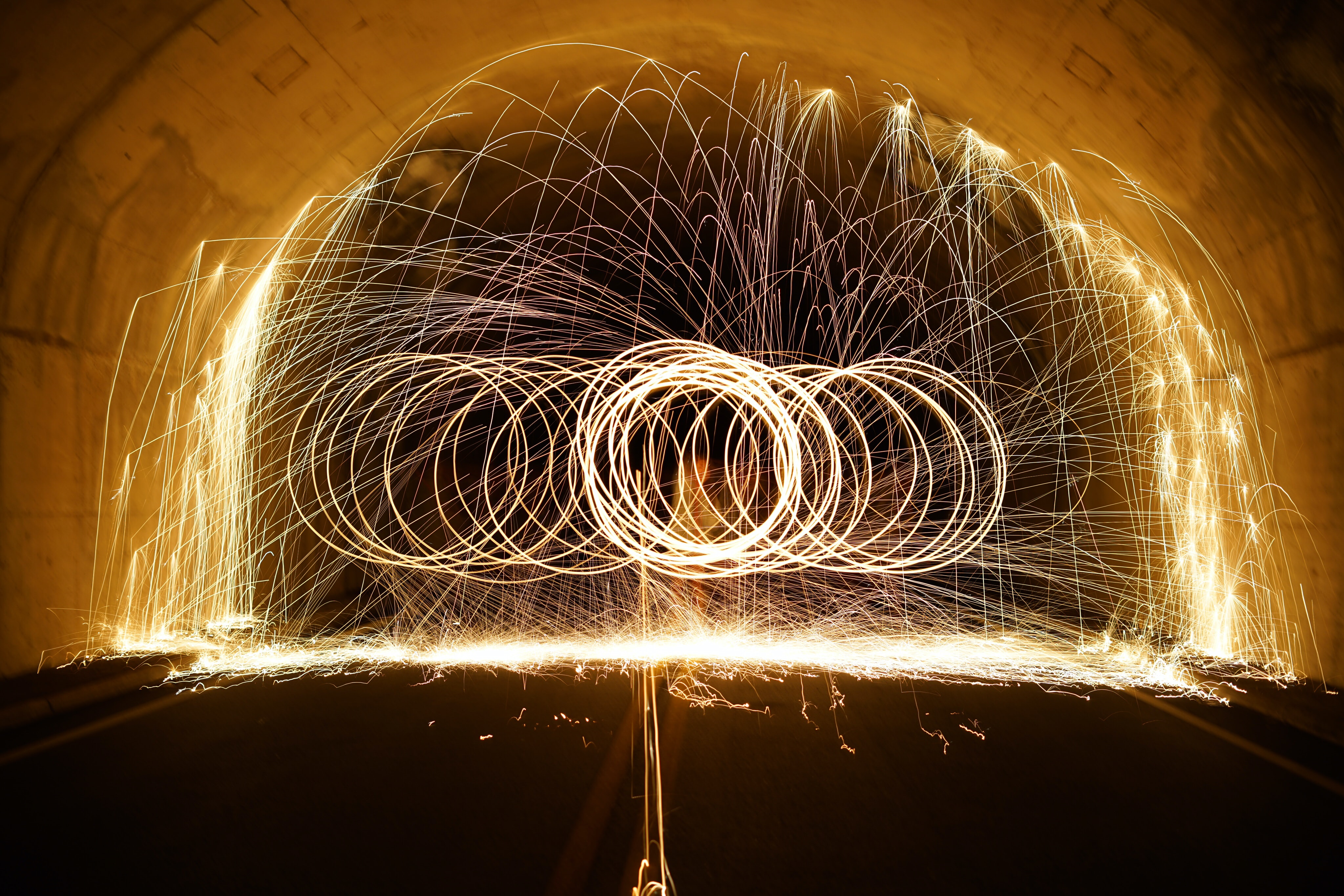 steel wool photography of tunnel at nighttime
