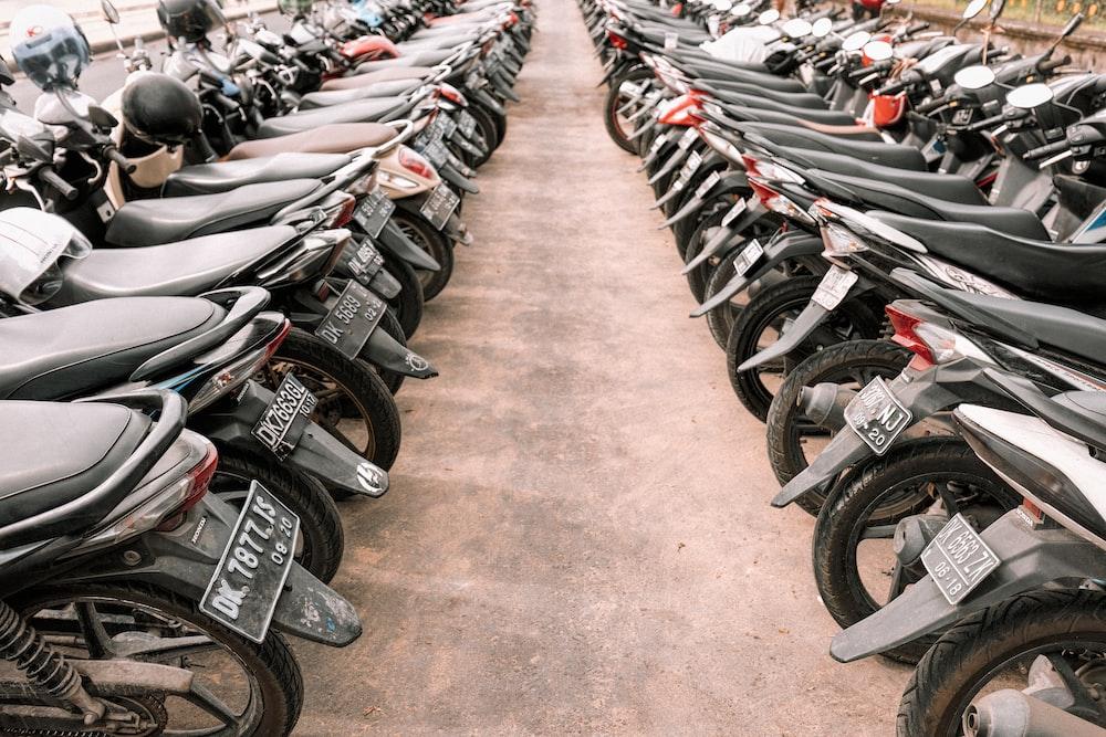 black underbone motorcycle lot on parking area