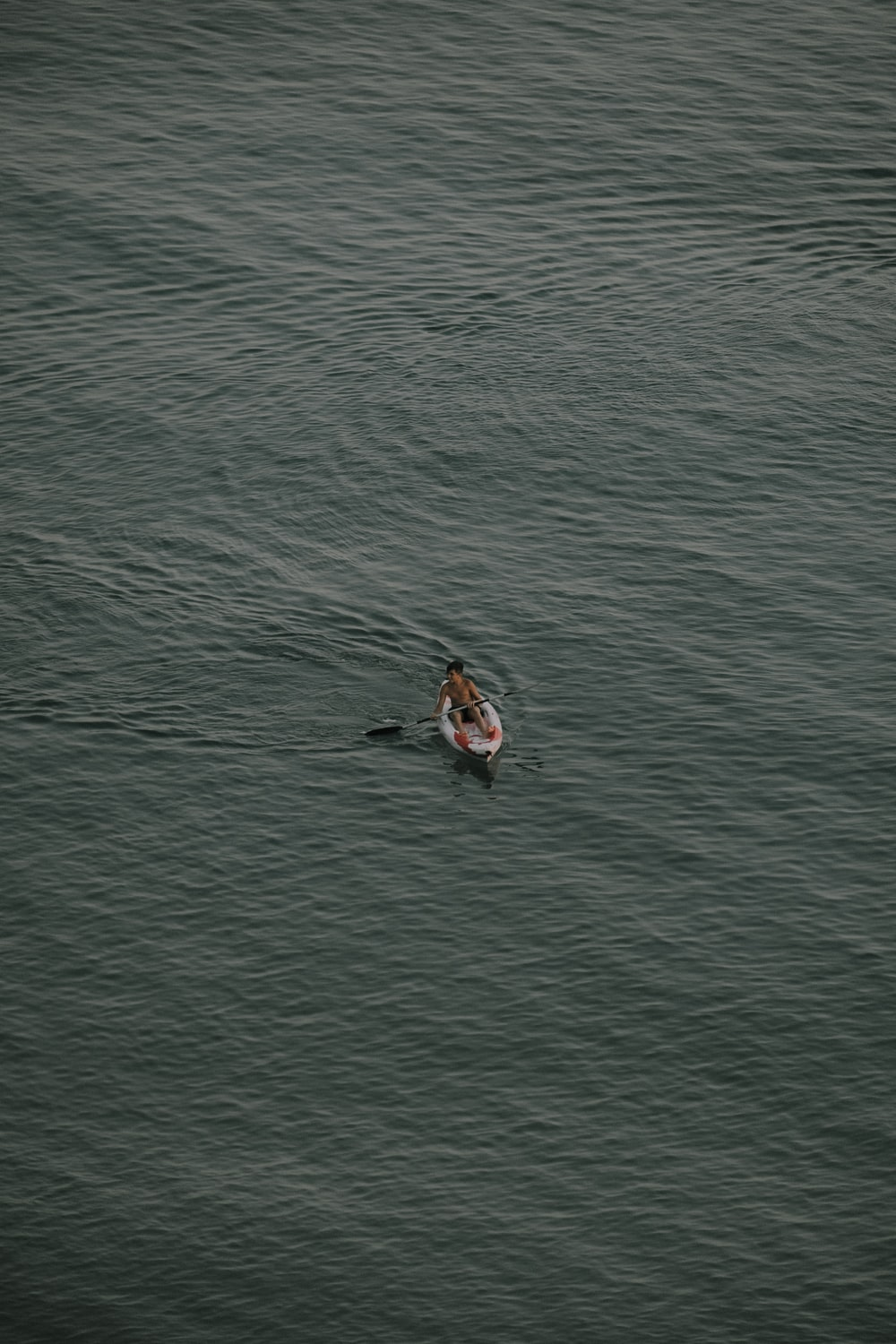 person kayaking on body of water
