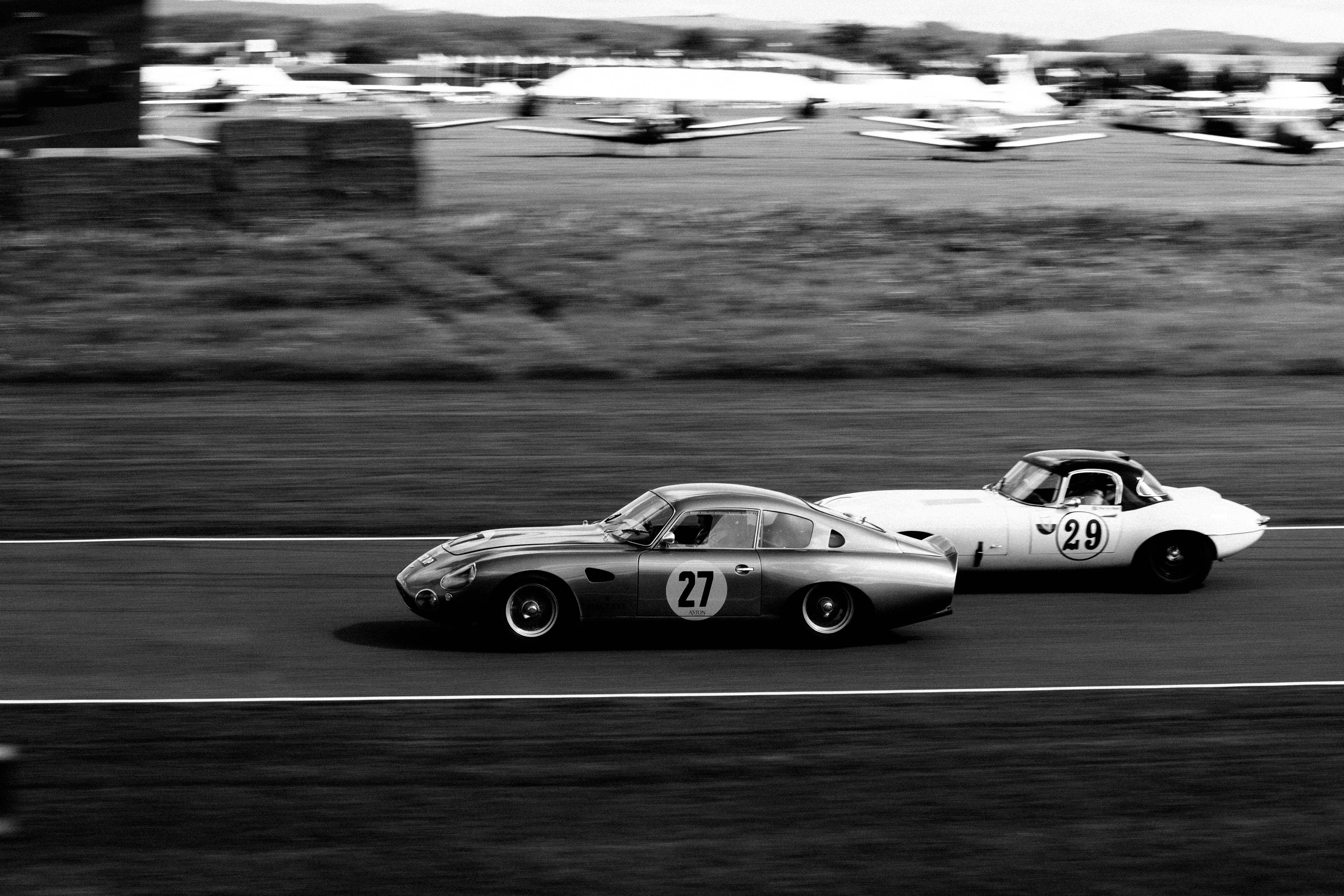 two vintage race cars racing